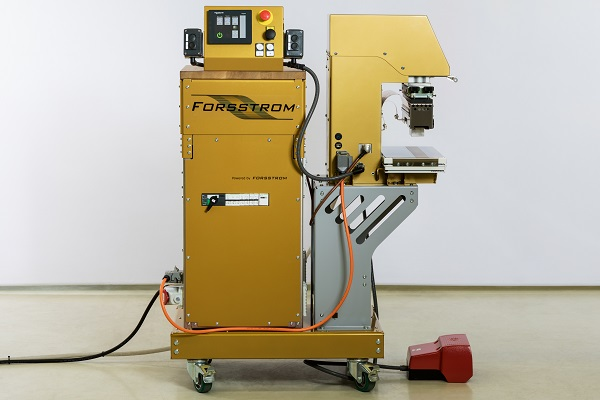 This is a photo showing Forsstrom's generator FG 120 with the table press TP.