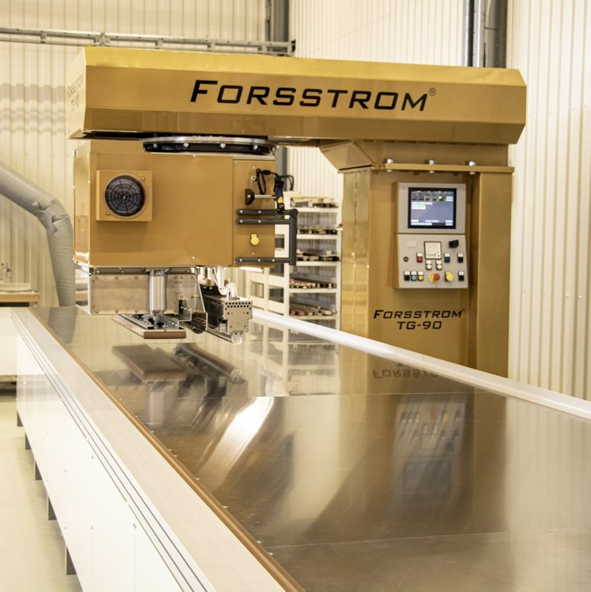 This is a photo of a table on Forsstrom's machine model TG-90 Mega