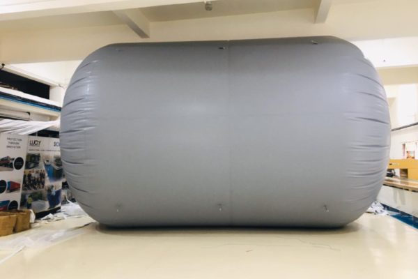 The photo shows a biogas balloon made in a Forsstrom HF-welding machine.