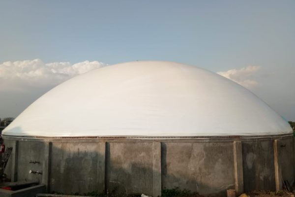 The photo shows a biogas dome produced in a Forsstrom HF-welding machine.